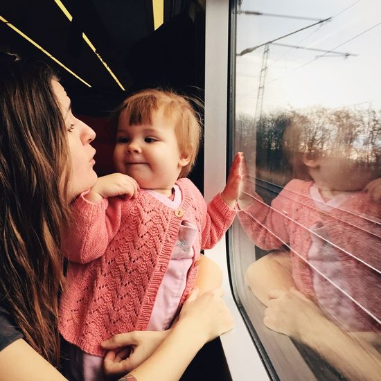 Everyday Joy Mother and Child Talking about Trains and Nature Dailylife Parenthood Childhood Babygirl