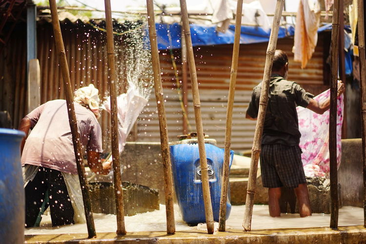 Dhobie Ghat Worlds Biggest Open Air Laundry Adult Adults Only Cleaning Day Floggingmolly Men Occupation Outdoors Washing Pen Water Working