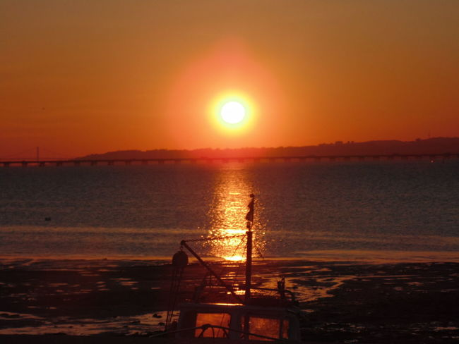 Sunset in Alcochete, Portugal. Beach Beauty In Nature Clear Sky Horizon Over Water Idyllic Leisure Activity Men Nature One Person Orange Color Outdoors Real People Reflection Scenics Sea Silhouette Sky Sun Sunlight Sunset Tranquil Scene Tranquility Vacations Water Wave
