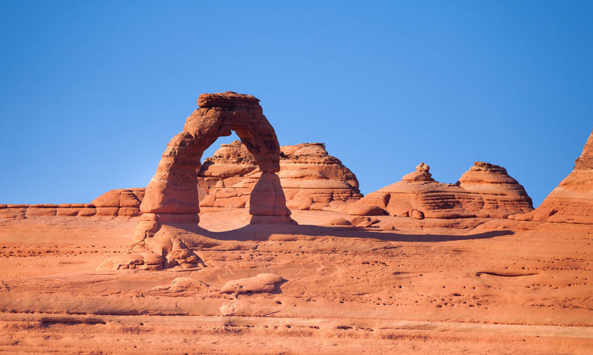 Rock formation in desert against clear blue sky
