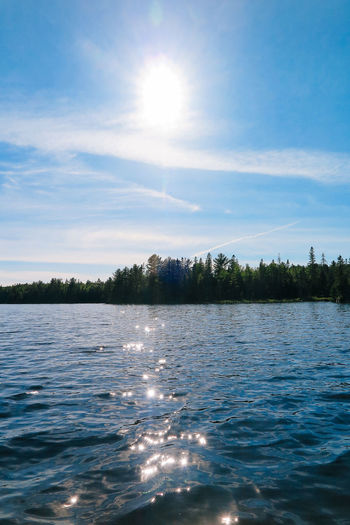 Algonquin Park Algonquinpark Algonquinprovincialpark Beauty In Nature Cloud - Sky Day Lake Nature No People Outdoors Reflection Rippled Scenics Sky Sun Sunbeam Sunlight Tranquil Scene Tranquility Tree Water Waterfront
