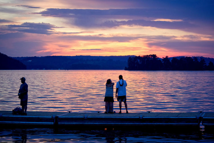 People on Pier Adult Beauty In Nature Cloud - Sky Couple - Relationship Fishing Leisure Activity Men Nature Outdoors People Real People Scenics - Nature Sky Sunset Togetherness Tranquility Two People Water Women