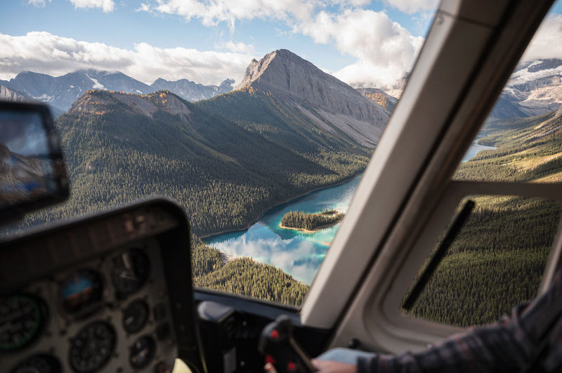 Aerial view of mountains seen through airplane window