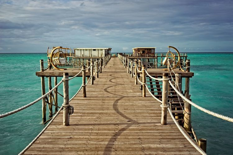 Walking path on a jetty. Leading Lines Beach Cloud - Sky Day Diminishing Perspective Direction Empty Horizon Horizon Over Water Jetty Long Nature No People Outdoors Pier Railing Rope Railing Scenics - Nature Sea Sky The Way Forward Tranquility Water Wood Wood - Material