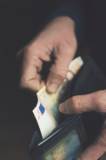 Cropped image of hand removing european union currency from wallet