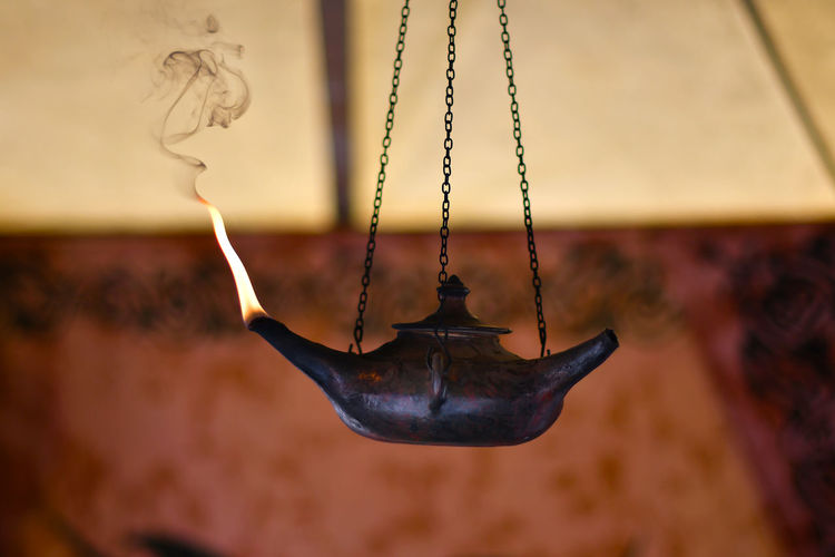 Burning Oil Lamp Hanging At Home