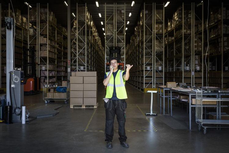 Full length portrait of man standing in building