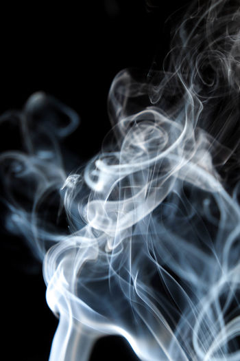 Abstract Black Background Blurred Motion Burning Changing Form Close-up Curve Emitting Heat - Temperature Illuminated Incense Indoors  Motion Nature No People Pattern Smoke Smoke - Physical Structure Studio Shot Swirl White Color