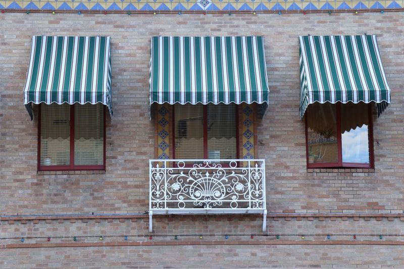 Windows, canopies & Balcony Built Structure Architecture Building Exterior Window No People Building Day Metal Wall - Building Feature Pattern Wall Outdoors Security Safety Blue Protection Hanging