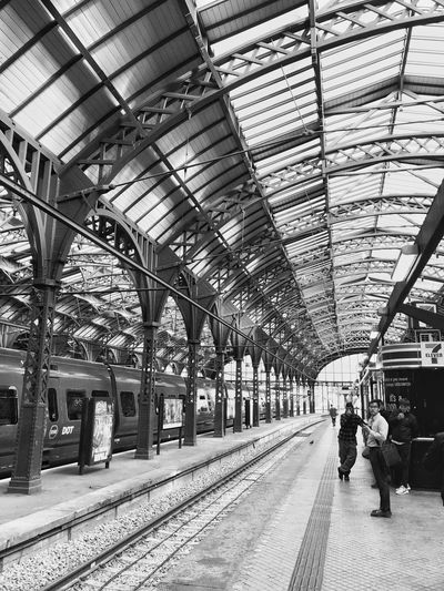 Architecture_bw Bnw_collection Bnw_captures Bnw_friday_eyeemchallenge Bnw_from_beneath Architecture Built Structure Group Of People Transportation Real People Indoors  Men Railroad Station Rail Transportation Public Transportation Railroad Station Platform Travel