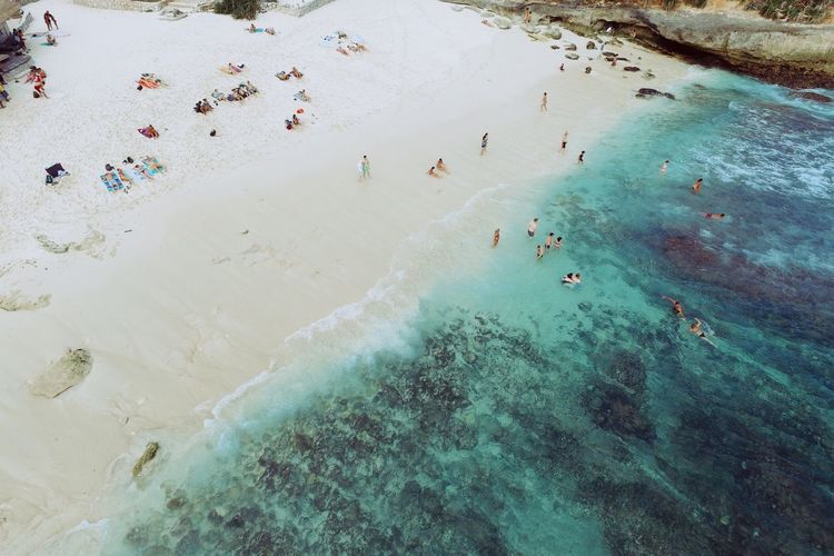 Aerial view of people enjoying at seaside