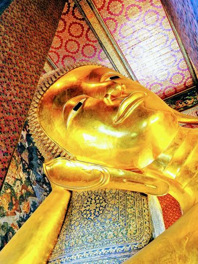Face of the reclining buddha. Wat Pho. BKK. TH. Face Of Buddha Image Spirituality Reclining Buddha Gold Colored Ancient Statue Illuminated Ancient Civilization Temple - Building Close-up Gold Place Of Religion Focus On Foreground Temple In Thailand Travelling Thailand BUDDHISM IS LOVE Arts Culture And Entertainment Place Of Worship Church Architecture Templephotography Temple Architecture Low Section Travel Destinations Multi Colored Buddha Temple