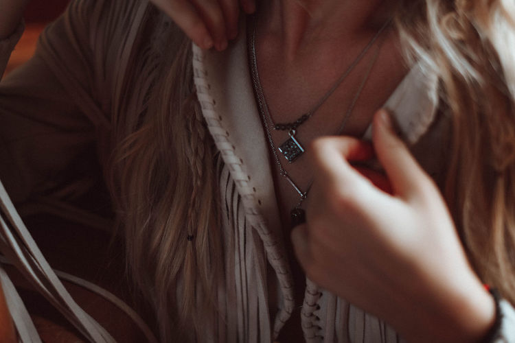 Details of beige jacket and accessories in hippie and boho style