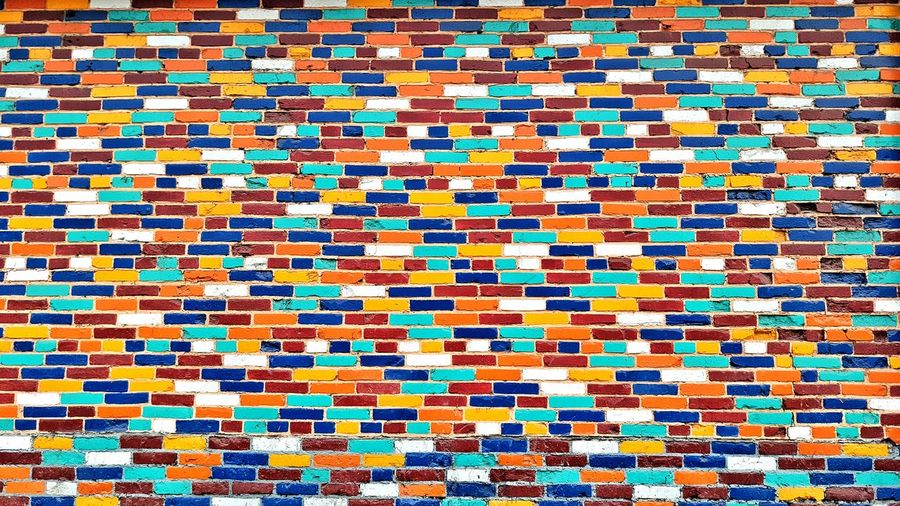 Full Frame Shot Of Multi Colored Brick Wall