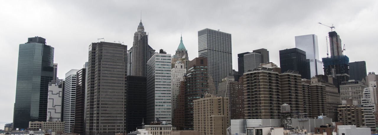 Low angle view of skyscrapers in city against sky
