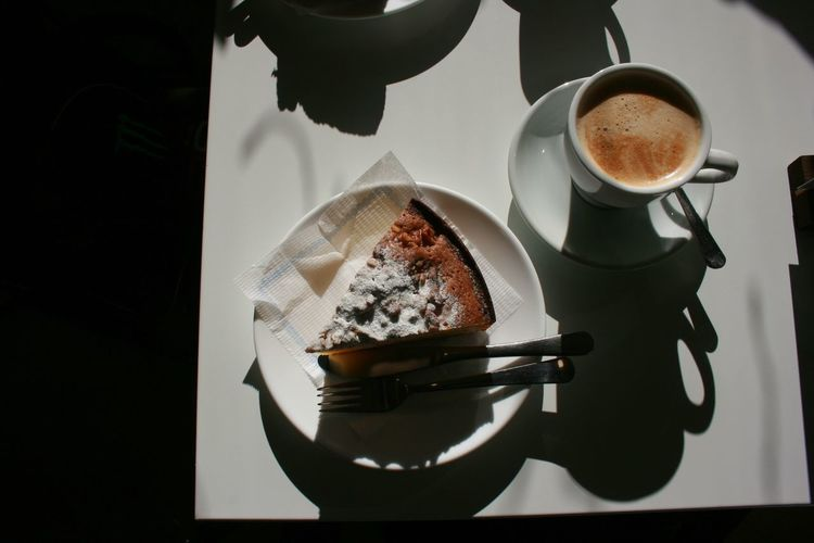 High angle view of cake and coffee on table