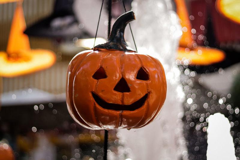 Jack o lantern hanging against fountain during halloween