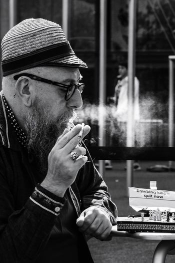 untitled. Portrait Portrait Photography Old Man Chess Player Street Photography Streetphotography Streetphoto_bw Street Life Malephotographerofthemonth Chess Board Human Hand Bad Habit Men Portrait Headshot Smoking - Activity Addiction Mid Adult Close-up Smoking