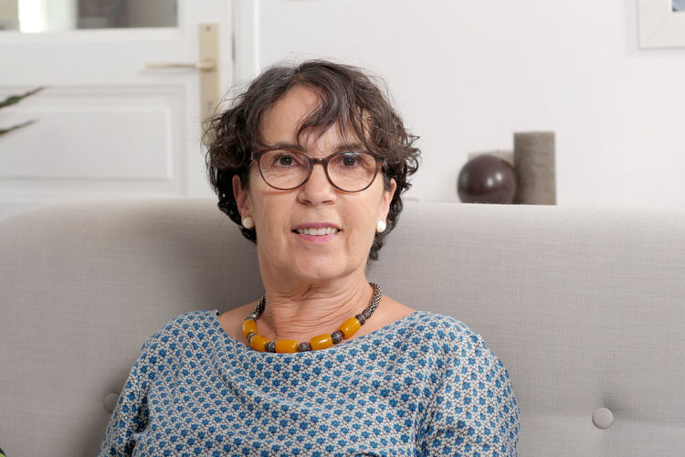a portrait of brunette mature woman with eyeglasses Woman Mature Eyeglasses  Portrait Smiling Brunette Happy People Middle One Lifestyle Looking Beautiful Caucasian Female Casual Serious Eyewear Cheerful Senior Aged person Home Face Relaxed 50 Fashion Middle-aged Glasses Age Years Adult Attractive Sitting 40 Old Dark-haired