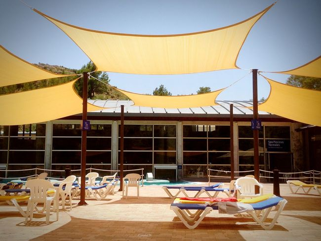 Butterfly Wings ~ EyeEm Selects Sunny Chair No People Travel Destinations Landscape Architecture Multi Colored Outdoors Breathing Space Life's Simple Pleasures... Built Structure Sunshades Poolside SPAIN Fortuna Thermal Spa Relaxing Serene Outdoors Investing In Quality Of Life Shade