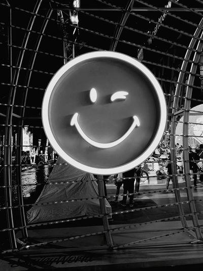 Close-up of illuminated ferris wheel in city