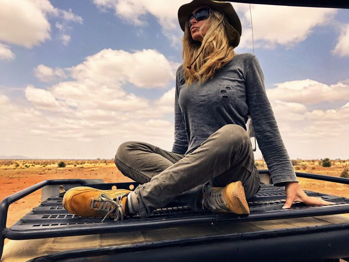 Woman Sitting On Off-Road Vehicle At Tsavo East National Park