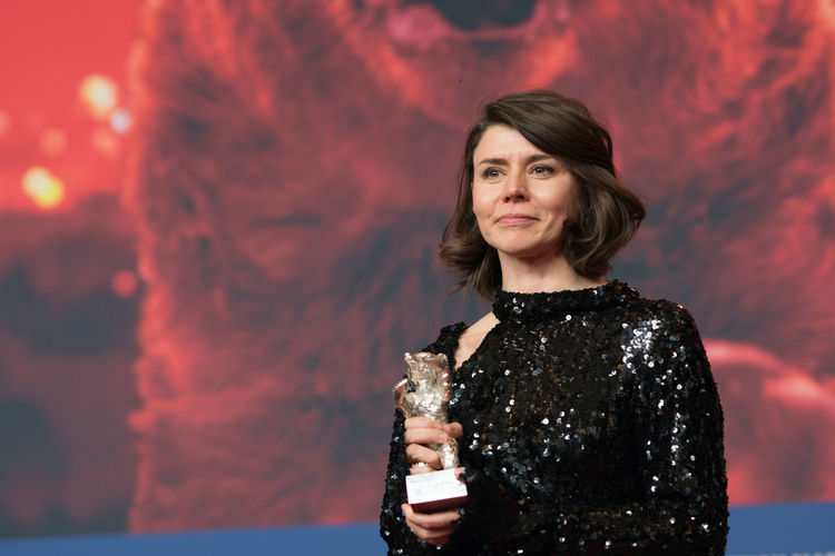 Berlin, Germany - February 24, 2018: Malgorzata Szumowska, winner of the Silver Bear Grand Jury Prize for 'Mug', poses on the red carpet after the closing ceremony during the 68th Berlinale Festival AWARD Artist Berlin Event Film Festival Press The Media Winning Arts Culture And Entertainment Berlinale Berlinale 2018 Berlinale2018 Berlinale68 Entertainment Entertainment Event Film Industry Holding Jury Prize Malgorzata Szumowska Mass Media Mug One Person Portrait Press Conference Silver Bear