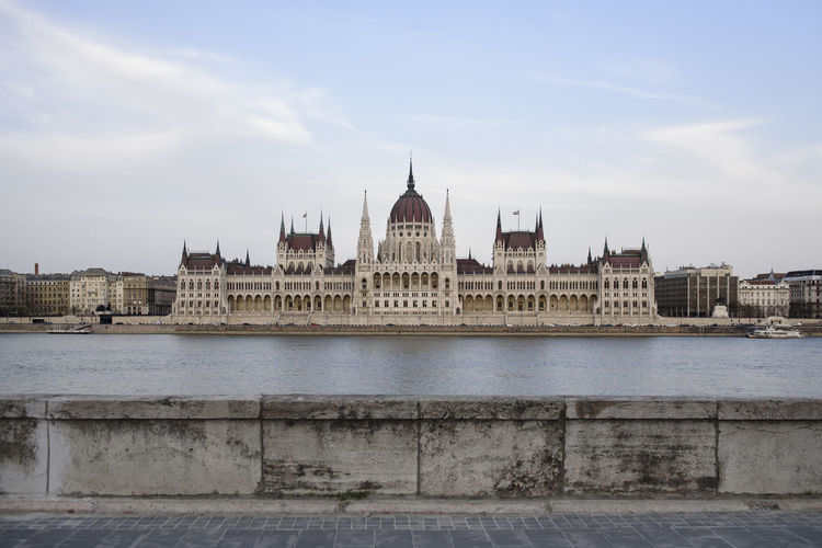 View of the Parliament of Hungary from the other side of the Danube river Architecture Building Exterior Built Structure City Cloud - Sky Day Gothic Style Government Nature No People Outdoors River Sky Tourism Travel Travel Destinations Water Waterfront