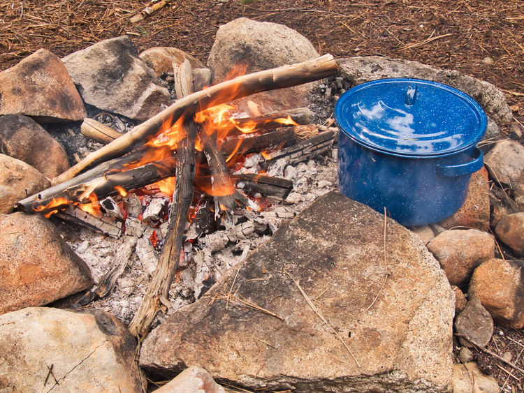Camp cooking in the Sierra Nevadas. Camping Camping Life Cooking Barbecue Burning Camp Cooking Campfire Camping Stove Fire Flame Food High Angle View Outdoors Pot Preparing Food Camp