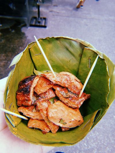 High angle view of food in leaves on table