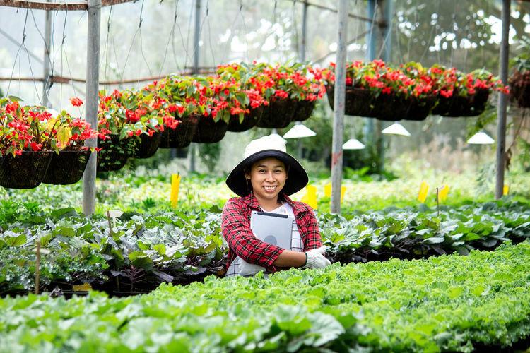 Portrait of smiling girl on plants