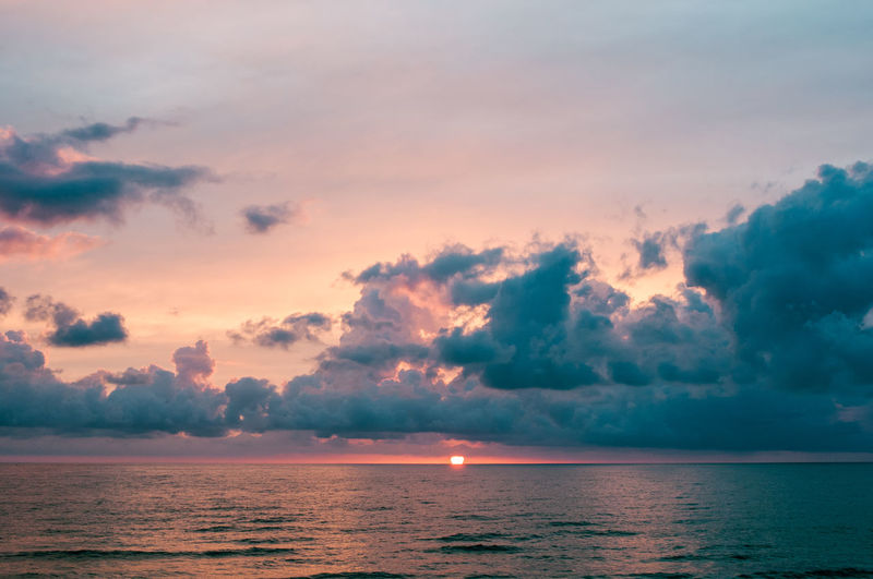 Sunset at the sea with clouds Cloud Cloudscape Dream Orange Sunlight Beach Beauty In Nature Cloud - Sky Dramatic Dusk Expanse Horizon Horizon Over Water Nature Scenics Sea Sky Summer Sunset Sylt Tranquility Water