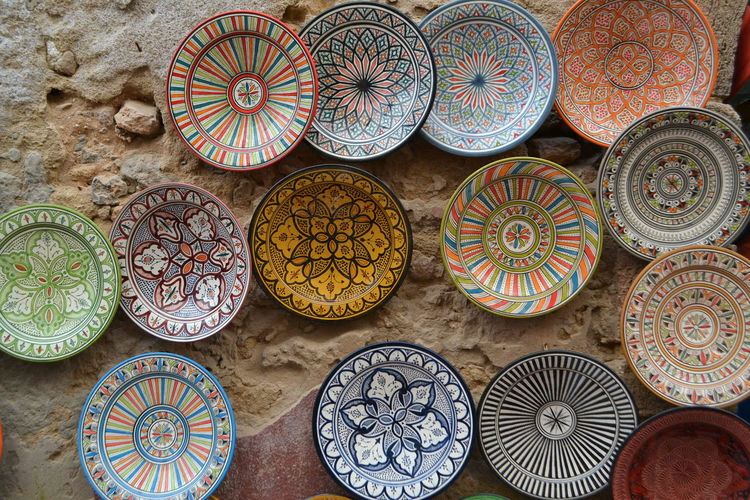 Close-Up Of Multi Colored Plates For Sale At Market Stall