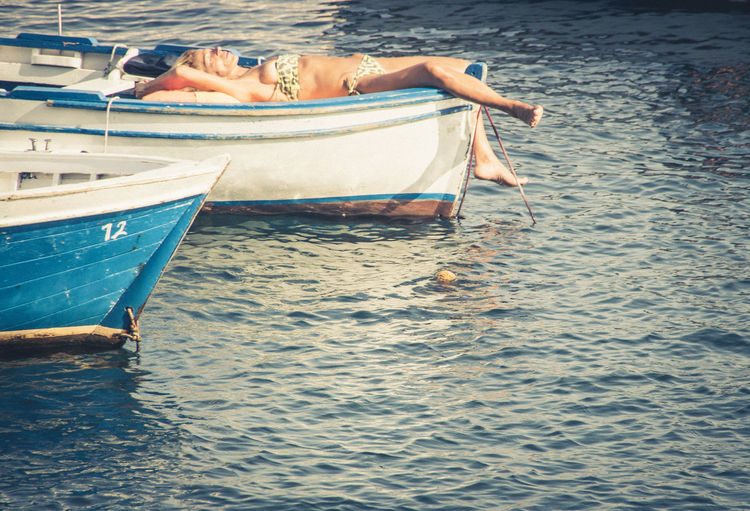 Sun Tan Sleeping Water Nautical Vessel Transportation Mode Of Transportation Sea One Person Relaxation Leisure Activity Nature Waterfront Holiday Adult Lifestyles Tranquility Day Trip Vacations Real People Outdoors Teenager Sunbathing Sunbath Relaxing Week End Holidays Decompression Decompressing Live It Up Mediterranean Sea Naples
