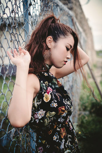 Beautiful young woman looking away outdoors