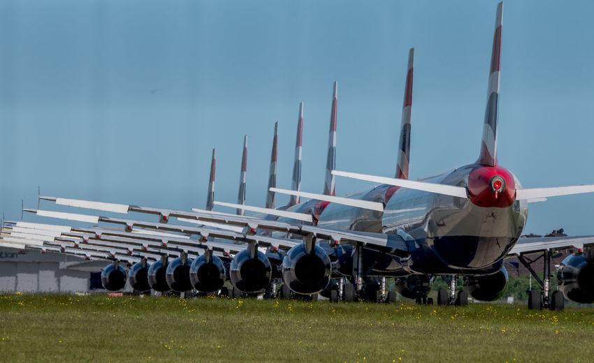 Group of people on airport runway