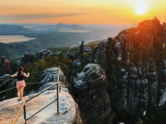 on top of the world Mountain Sky Sunset Beauty In Nature Lifestyles Nature Leisure Activity Mountain One Person Outdoors Scenics - Nature Orange Color Sunlight