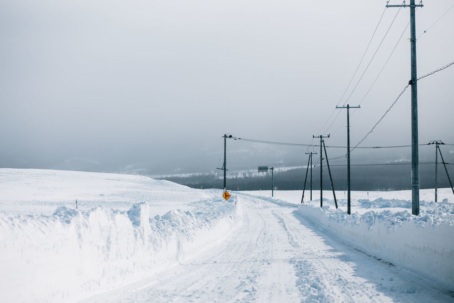 Beauty In Nature Cold Temperature Day Deep Snow Furano Hokkaido Landscape Mountain Nature Outdoors Road Sky Snow Snowing Tranquility Travel Destinations Winter