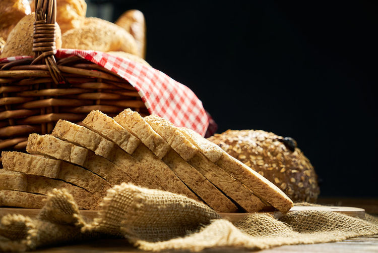 Close-up of breads against black background