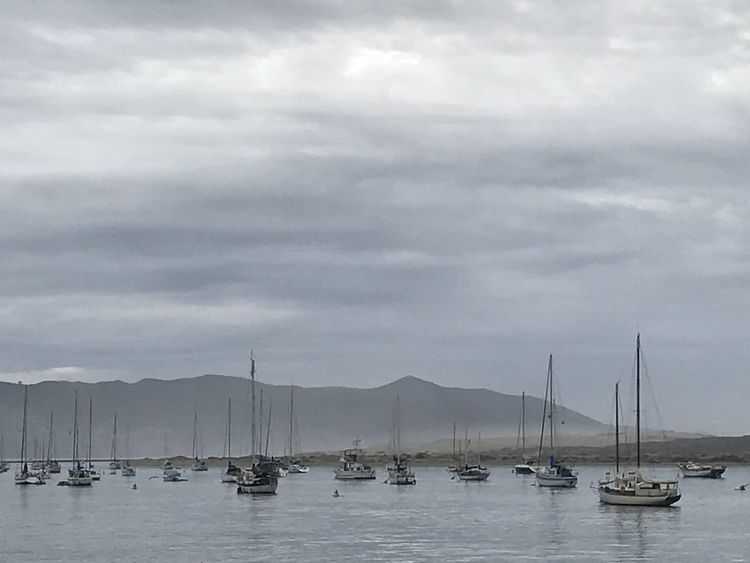 Beauty In Nature Boat Cloud - Sky Day Harbor Mast Mode Of Transport Moored Mountain Mountain Range Nature Nautical Vessel No People Outdoors Sailboat Sailing Sailing Ship Scenics Sea Sky Tranquility Transportation Water Waterfront Yacht