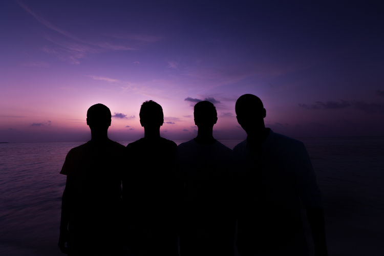 Silhouette Of Men Standing During Sunset