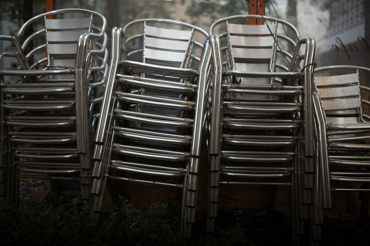 Close-up of stack of metal chairs