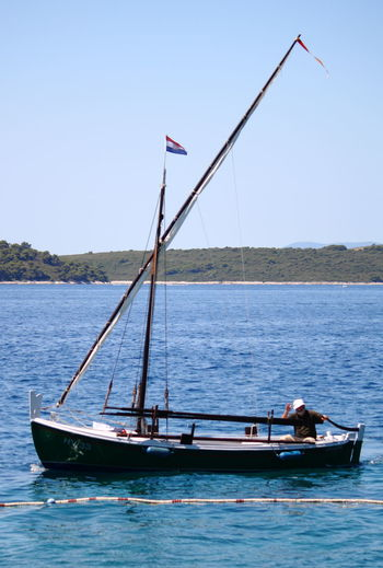 Come about Adventure Afloat Afloat Boat Clear Sky Environmental Conservation Fisherman Hobbies Mast Mode Of Transport Moored Nautical Vessel Outdoors Paradise Afloat Sailboat Sailing Sailor Sea Sky Transportation Travel Vacations Water Waterfront Weekend Activities