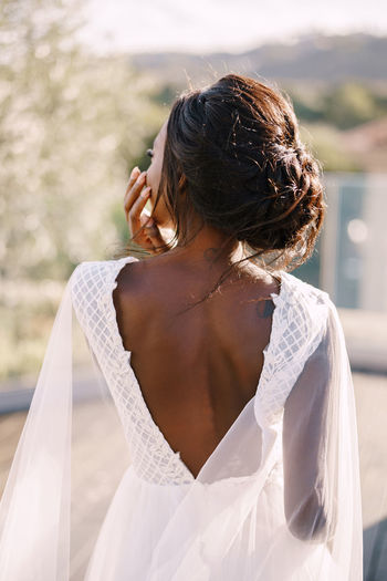Rear view of bride standing outdoors
