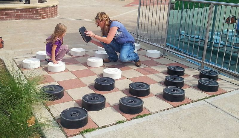 Game of Checkers. Games Funtimes Playing Checkers Enjoying Life Hanging Out Outdoors Giant BigBiggerBiggest Challenge Dayoff Daytrip Check This Out Win Lose Or Tie