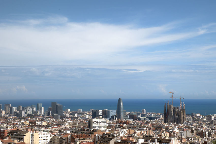 Barcelona's waterfront with mediterranean sea at background Architecture Crowd Building City Skyscraper TOWNSCAPE Outdoors Settlement Crowded Cloud - Sky Cityscape Barcelona Urban Skyline Sky Mediterranean  Sea