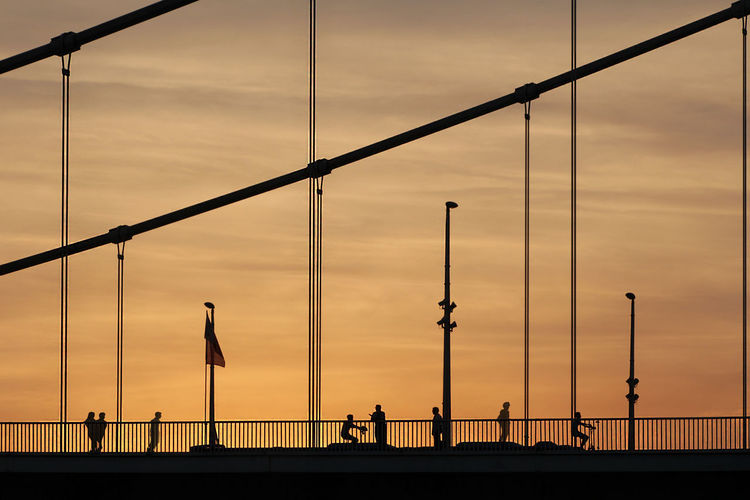 Elisabeth Bridge, Budapest (Photo: Janos Eifert) Budapest, Hungary Eifert János Elisabeth Bridge Architecture Bridge Bridge - Man Made Structure Building Exterior Built Structure Cloud - Sky Connection Evening Sky Group Group Of People Lifestyles Nature Orange Color Outdoors Railing Real People Silhouette Sky Sunset Transportation Travel