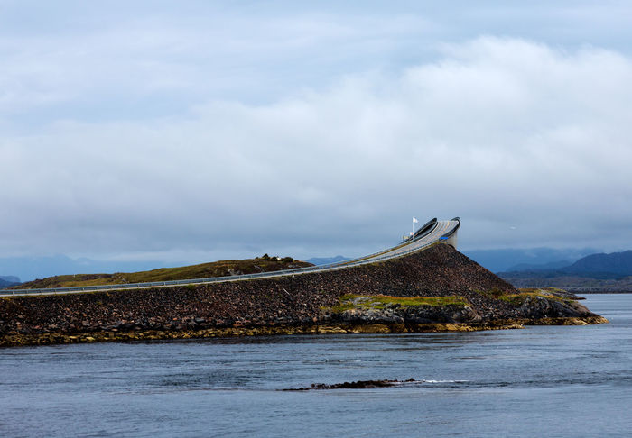 Landscape of Norway, Atlantic Ocean Road. Atlantic Road Eide Norway Travel Atlantic Ocean Road Beach Beauty In Nature Cloud - Sky Day Environment Idyllic Land Landscape Mountain Nature No People Non-urban Scene Norway Nature Outdoors Scenics - Nature Sea Sky Tranquil Scene Tranquility Water