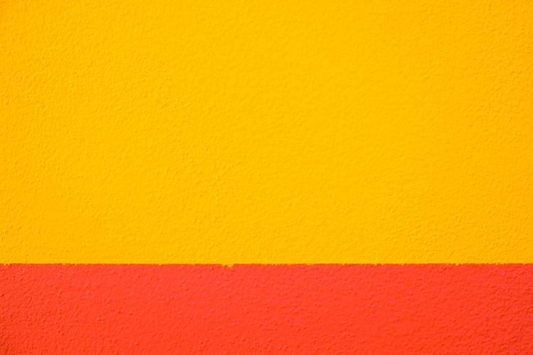 Abstract geometric pattern on concrete wall Abstract Architecture Backgrounds Blank Building Exterior Built Structure Close-up Concrete Copy Space Day Full Frame No People Orange Color Paint Pattern Red Textured  Vibrant Color Wall Wall - Building Feature Yellow