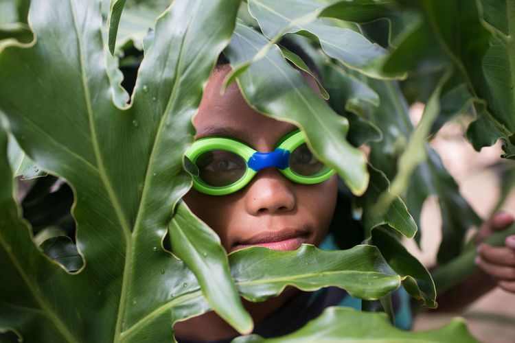 Hide out Boys Childhood Close-up Day Eyeglasses  Green Color Growth Headshot Leaf Looking At Camera Nature One Person Outdoors People Plant Portrait Real People Sunglasses